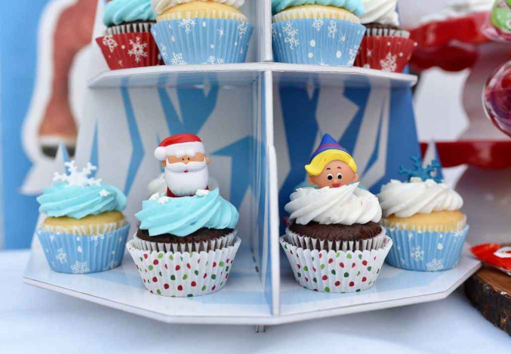 Rudolph the Red-Nosed Reindeer party cupcakes with Santa and Hermey the elf