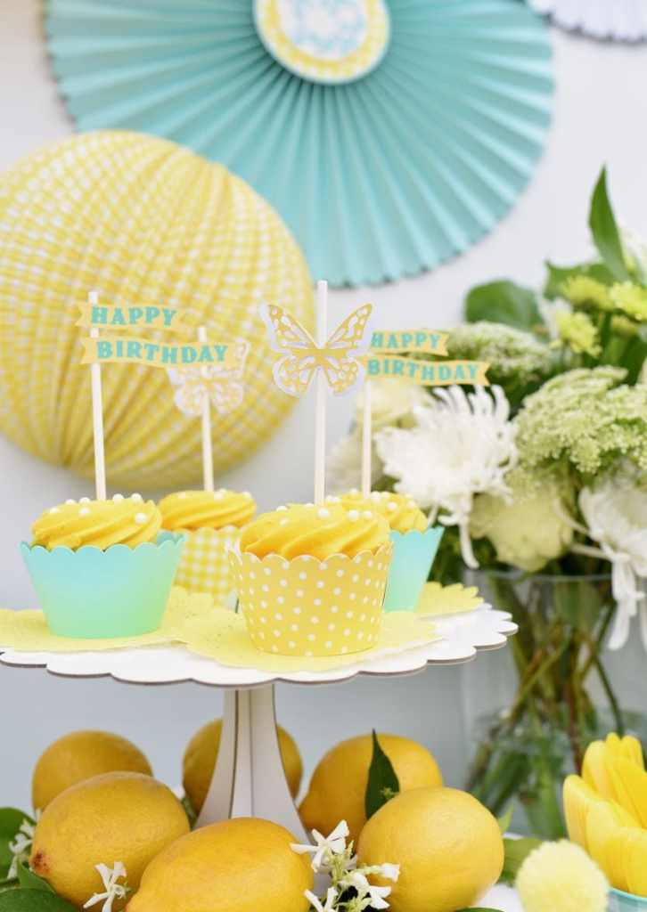 Butterfly cupcake toppers with Martha Stewart Cricut Explore Air 2 at yellow birthday party