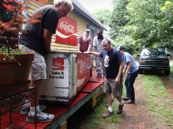 Moving the Coca Cola cooler.