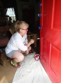 Day 5: Alicia put a fresh coat of red on the door.