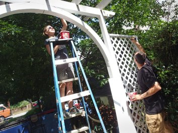 Day 5: Julie and David put the white top coat on the pergola.