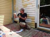 Day 1: Paul does a caulking demonstration.