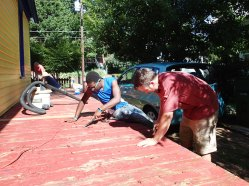 Day 4: Thaddeus and John scrape the porch.