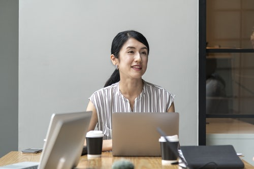 woman sitting at a desk with a computer