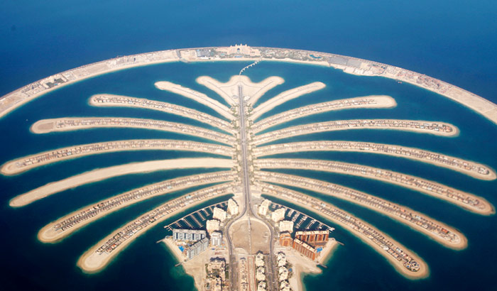 A stunning sky view of Dubai's prime attractions Palm Jumeirah and The World