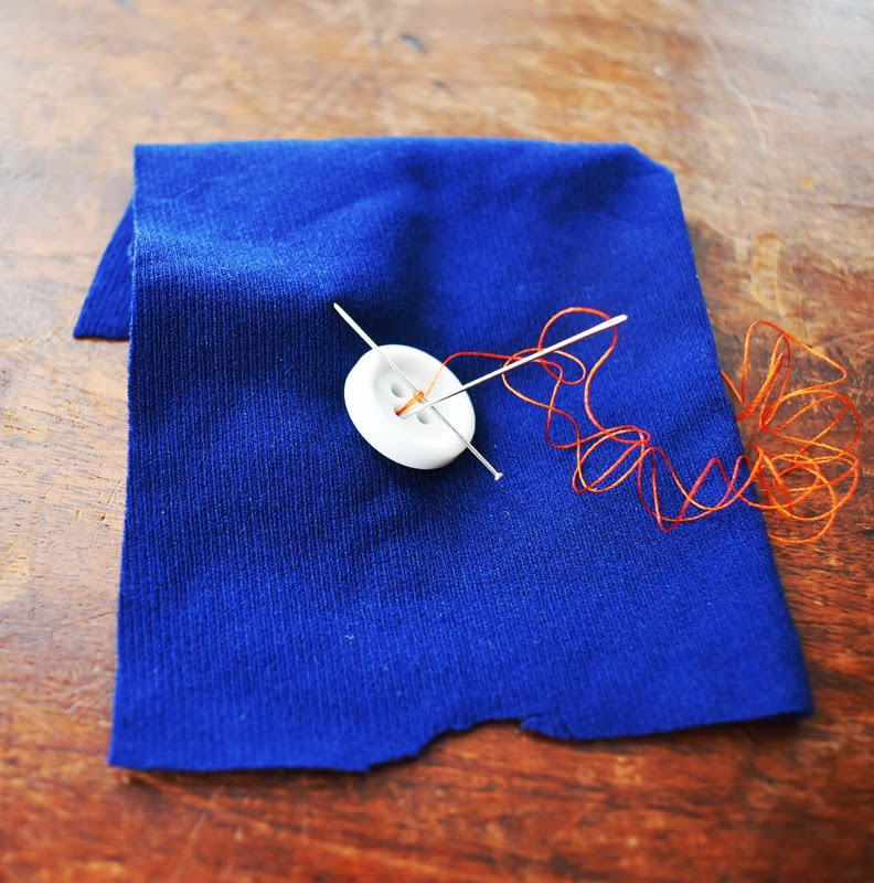 button being sewn