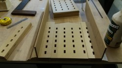Mill walls in a glue jig ensuring they are all to the correct size.
