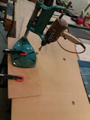 a morticer set up to drill holes in the desk top