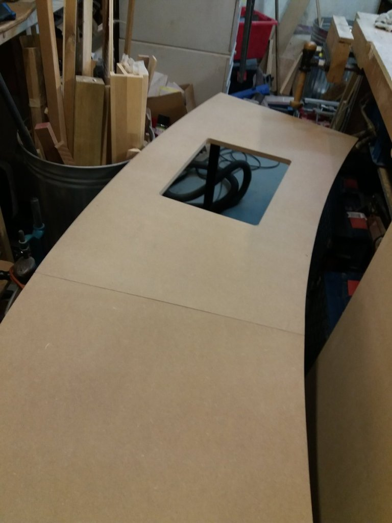 the curved desk top with hatch cut in it