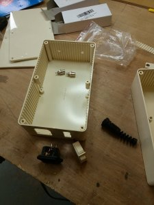 a plastic box adapted with holes cut for wiring