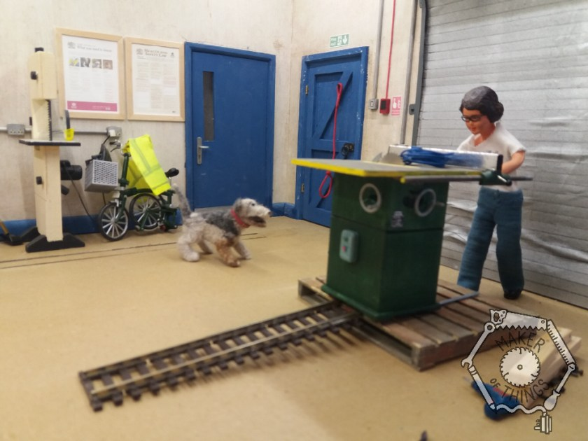 Harriet has pushed the table saw onto the end of the railway track ramp.