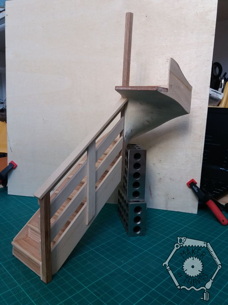 Room side view of the staircase with hand rail fitted. A simple 1970s style of three 'horizontal' boards following the slope of the stairs.