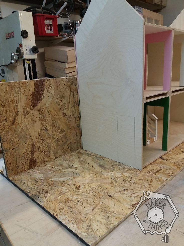 A left side view of the dolls house set on the OSB