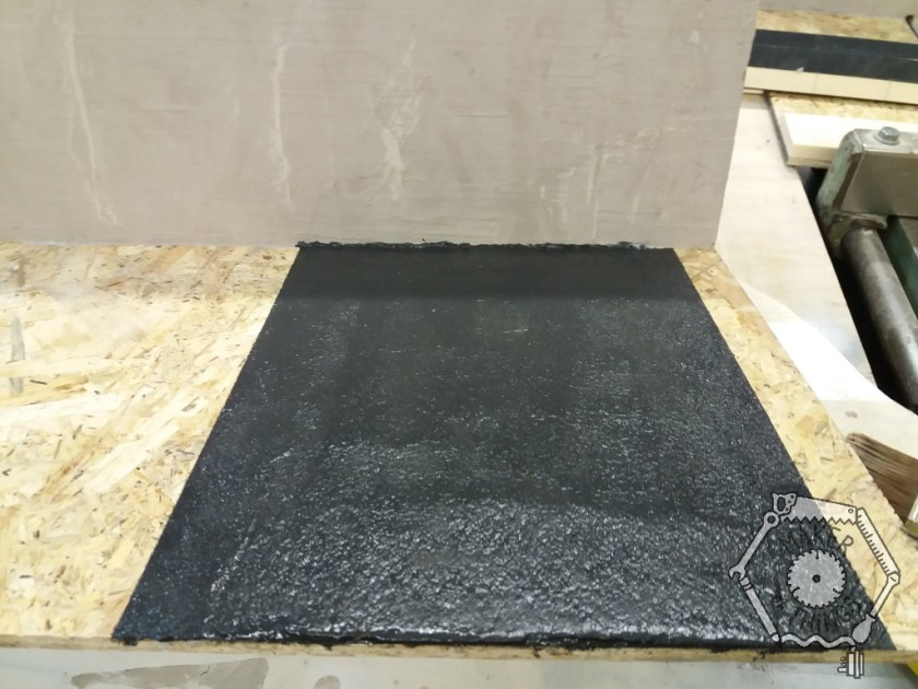 A black road surface plasted onto the OSB base board.