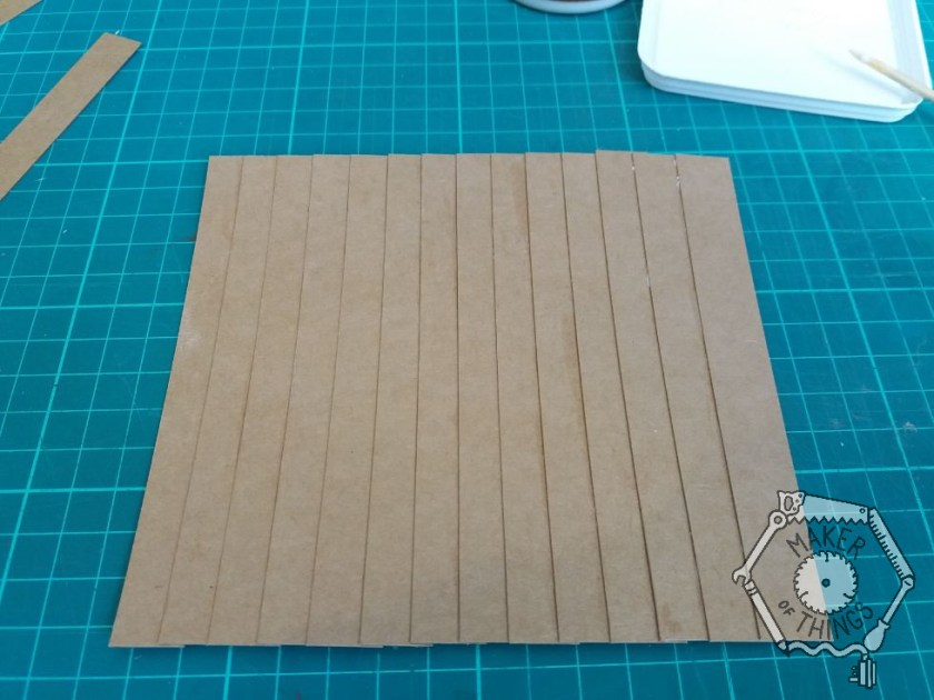 A finished brown cardboard fence panel blank.