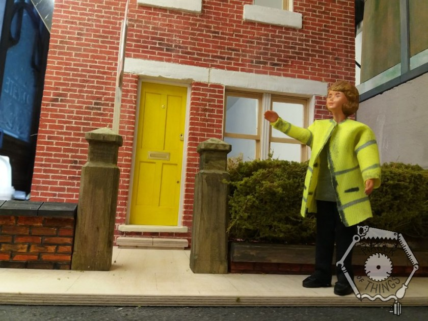A close up of Daisy pointing at the 'For Sale' sign at the front of the house.