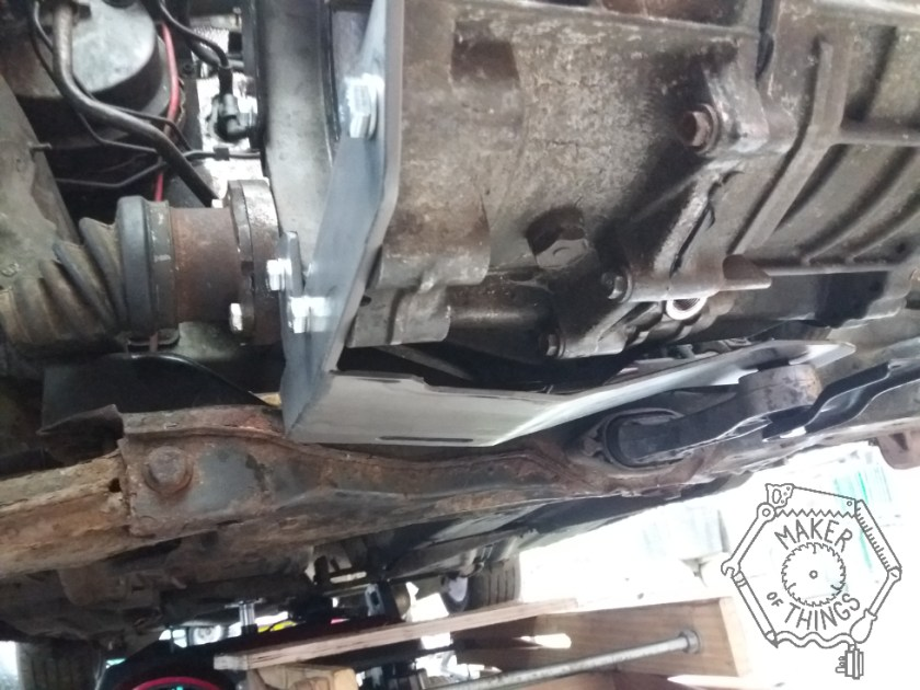 The steel plate welded to the bell housing brace and bolted in place.