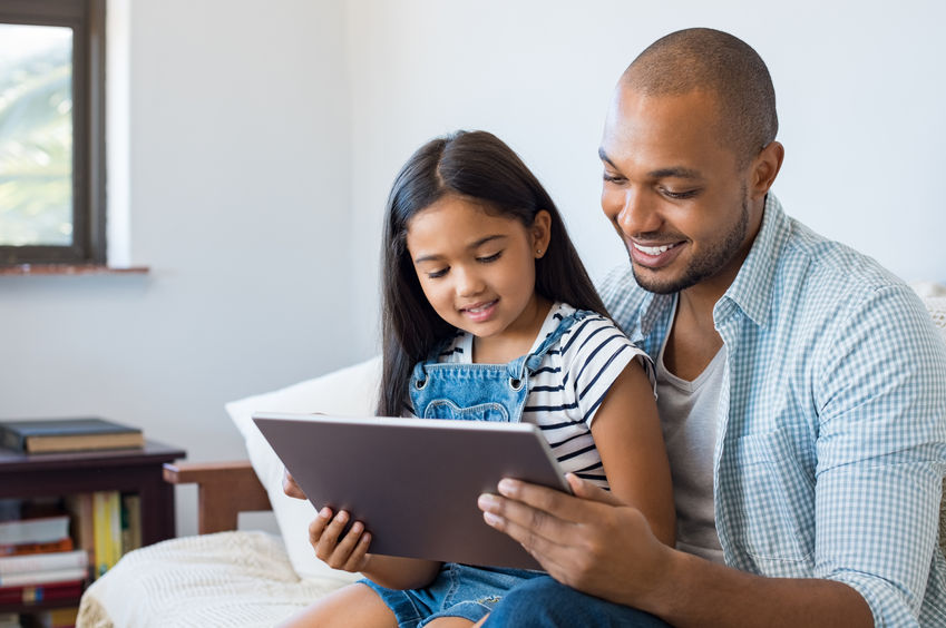 Father-and-daughter-using-tablet
