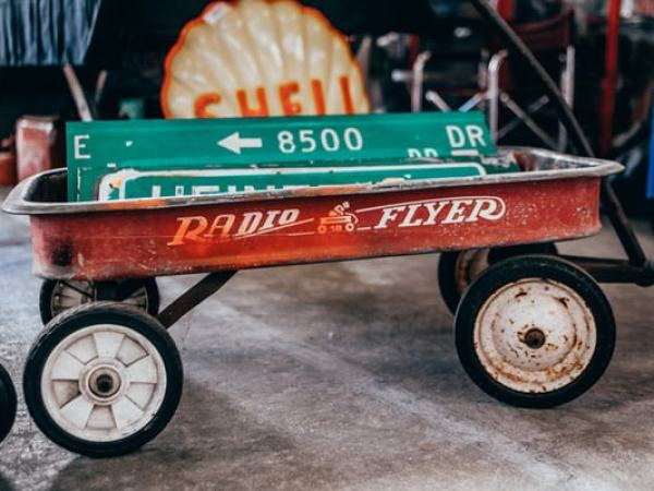 rusted vintage red wagon cart