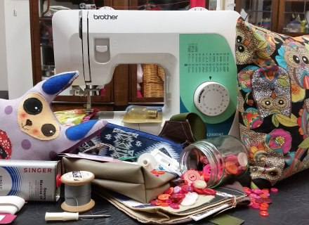 Sewing Machine, Sewing Machine Oil, Cushion, Soft Toy, Buttons, Thread, Screwdriver, Spare Bulb, Craft Materials, Handmade Bag