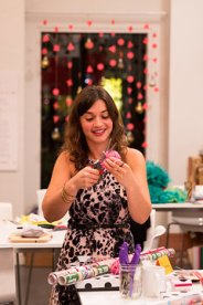 Roxie showing us how to make crepe paper flowers