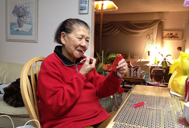 From two Christmases ago --- my granny touching up her red lipgloss!