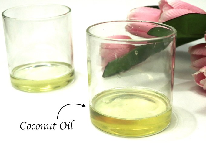DIY Castor and Coconut Oil Deep Conditioning Mask For Hair Growth Coconut Oil in a glass container