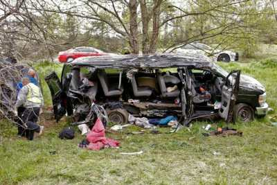 "Investigators work at the scene where three people died early Monday, April 6, 2015, when a van carrying members of two heavy metal bands crashed near the town of Commerce, Ga., about 65 miles northeast of Atlanta, according to authorities. Members of the Atlanta-based band, ""Khaotika, "" and the Huntsville, Ala.-based band, ""Wormreich, "" were in the van. Georgia State Patrol Cpl. Scott Smith said the driver of the 15-passenger van ""apparently fell asleep and allowed the vehicle to leave the roadway, at which time the vehicle struck a tree on the passenger side."" (AP Photo/Atlanta Journal-Constitution, Bob Andres) MARIETTA DAILY OUT; GWINNETT DAILY POST OUT; LOCAL TELEVISION OUT; WXIA-TV OUT; WGCL-TV OUT"