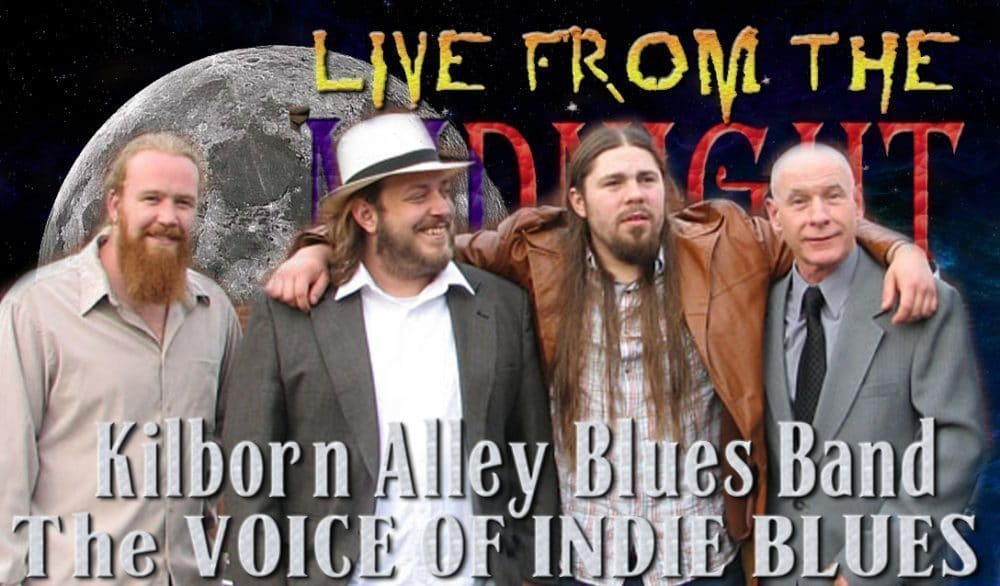 "<a class=""amazingslider-posttitle-link"" href=""http://www.makingascene.org/live-midnight-circus-featuring-kilborn-alley-blues-band/"" target=""_blank"">LIVE from the Midnight Circus Featuring The Kilborn Alley Blues Band</a>"