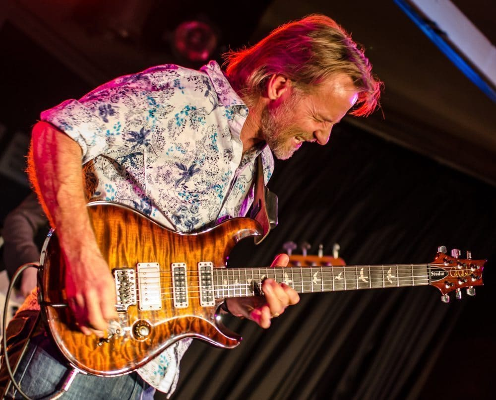 "<a class=""amazingslider-posttitle-link"" href=""http://www.makingascene.org/australian-bluesroots-guitar-sensation-geoff-achison-returns-u-s/"" target=""_blank"">AUSTRALIAN BLUES/ROOTS GUITAR SENSATION GEOFF ACHISON RETURNS TO THE U.S.</a>"