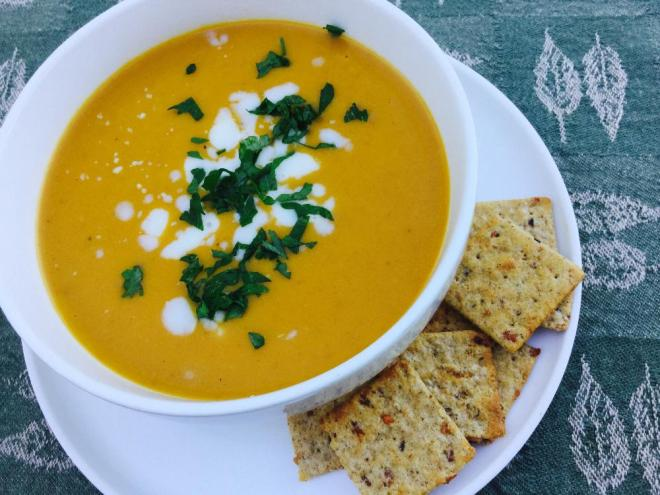 Bowl of Creamy Carrot Soup pictured with crackers