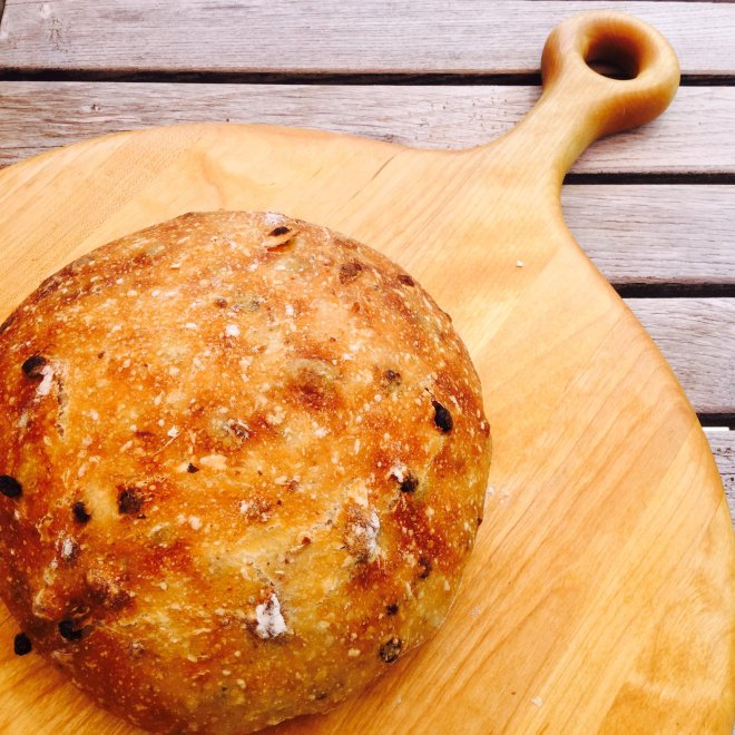 Beautiful Artisan Easy Sour Dough Bread pictured on a gorgeous cutting board