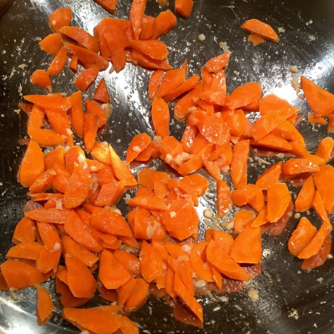 Stainless Steel Wok with stir fry carrots