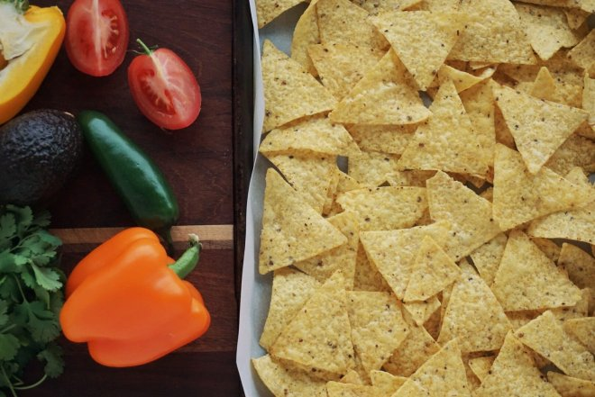 Tray of tortilla chips, peppers and tomatoes
