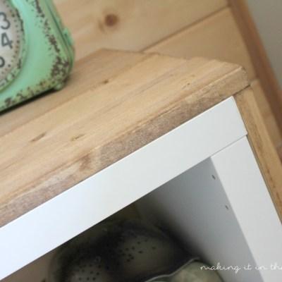 A Plain White Shelf with {Rustic Charm} – AKA: An IKEA Kallax Wrapped with Wood