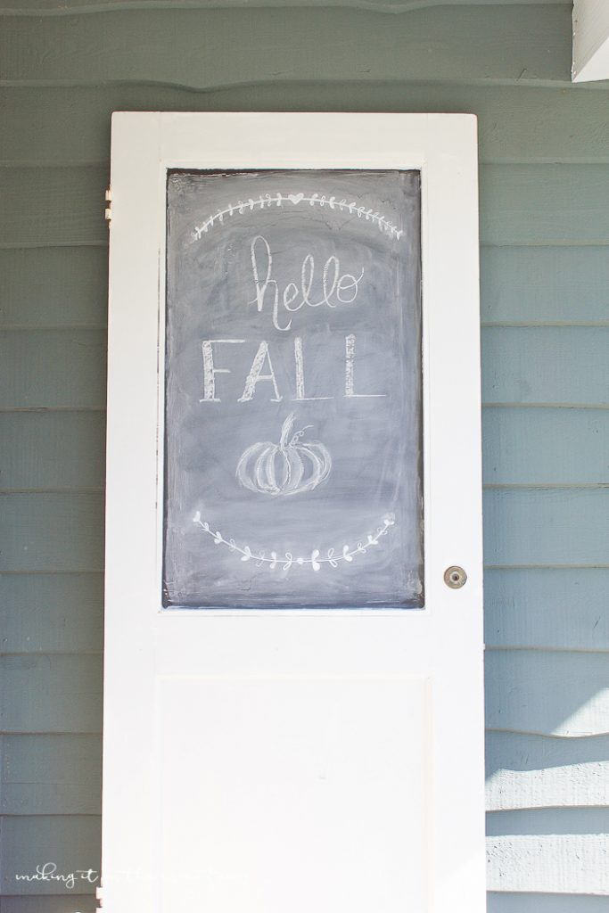 The easiest and most charming DIY chalkboard EVER! This DIY chalkboard made from a vintage door is so sweet and full of character!