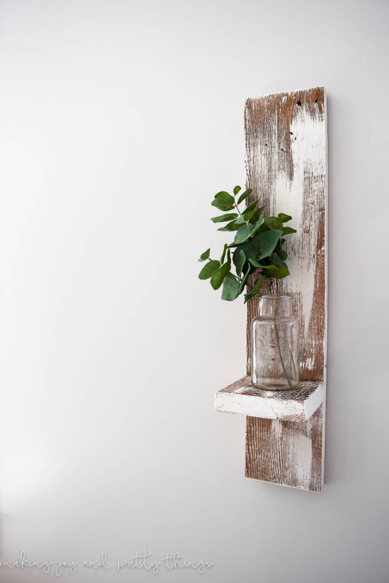 This reclaimed wood wall shelf is so simple to make and adds fixer upper and farmhouse style to any space