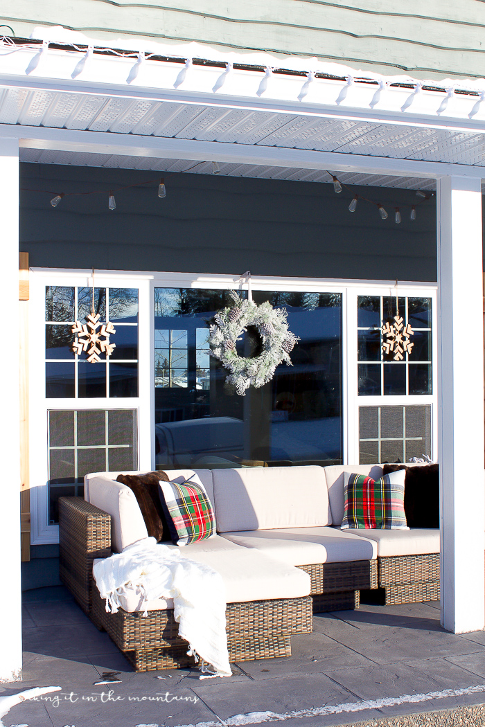 This farmhouse Christmas porch is so cozy and full of charm!