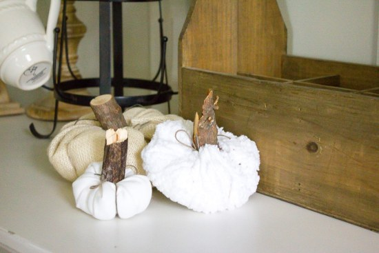These lovely little farmhouse style fabric pumpkins are the perfect way to bring a bit of farmhouse Fall to your home! Even better, they're SO quick + inexpensive to make!