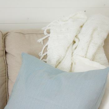 A simple farmhouse style DIY ticking stripe pillow you can whip up in 10 minutes or less!