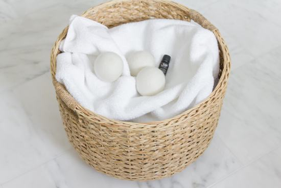 white towels, wool dryer balls, essential oil