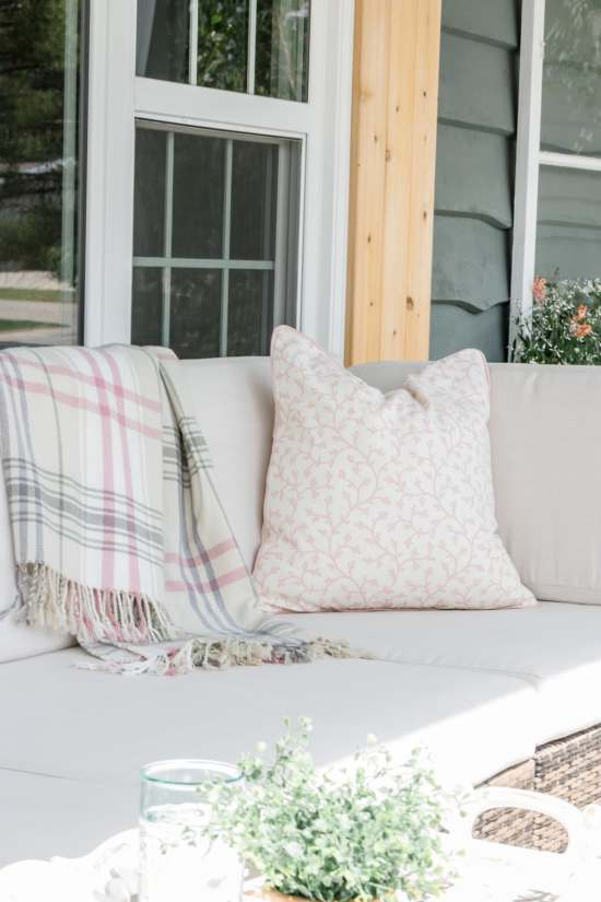 outdoor sofa, blanket, cedar shutter