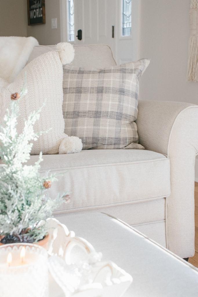candle, plaid pillow, pom pom knit pillow, mini tree, linen sofa