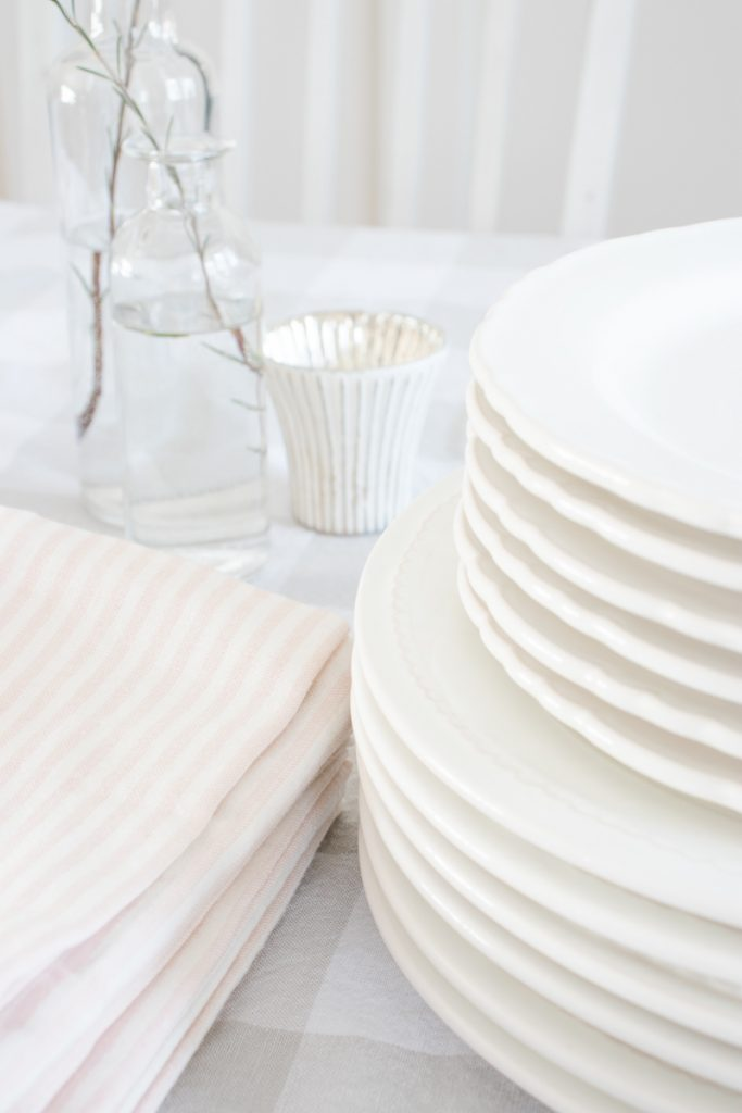 striped pink napkins, white dishes