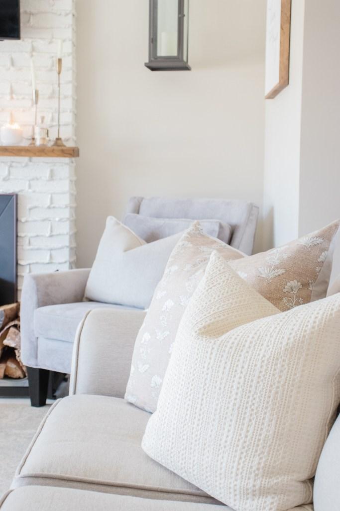 neutral couch cushions, linen sofa, grey chair