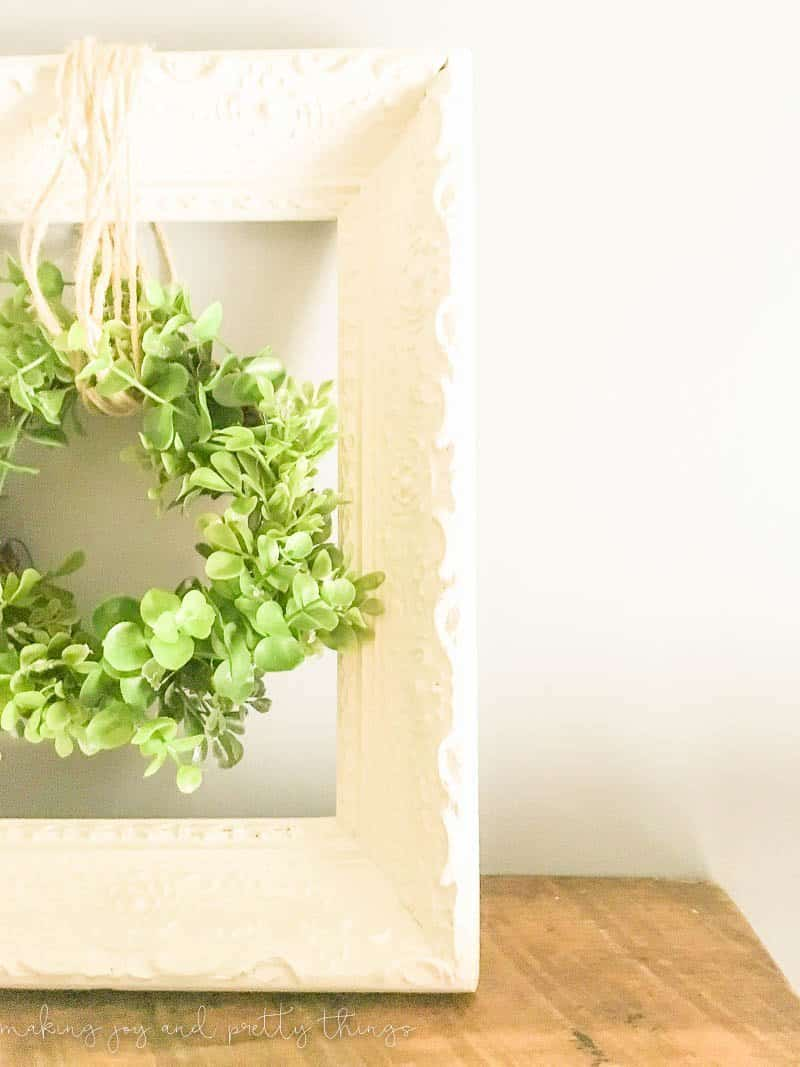 Simple Farmhouse Decor: Upcycled frame and wreath! Easy fixer upper and farmhouse style DIY that is budget friendly using an old frame. Add a fresh green wreath and it's a perfect farmhouse-inspired DIY