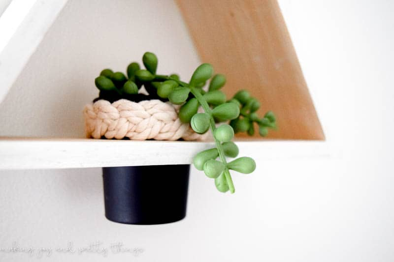 DIY Triangle Shelf Planter using a $3 Dollar Store Shelf and old play-doh container. Dollar store craft | DIY craft | upcycle | planter ideas | succulents