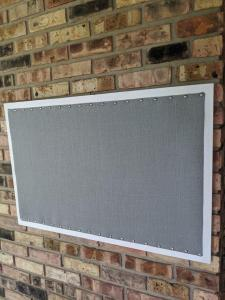 Magnet board with white frame and gray linen fabric photo