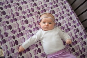 purple watercolor crib sheets with baby