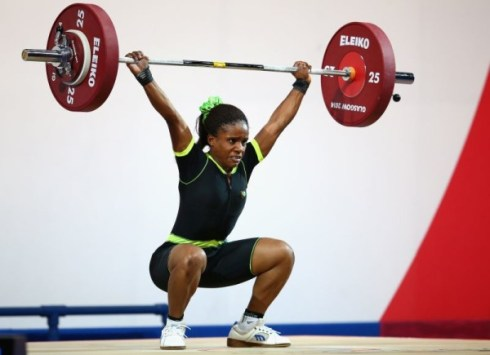 Chika Amalaha of Nigeria competes in the Women's 53kg Group A Weightlifting at the Scottish Exhibition And Conference Centre at the Glasgow 2014 Commonwealth Games on July 25, 2014 (Photo by Julian Finney/Getty Images)